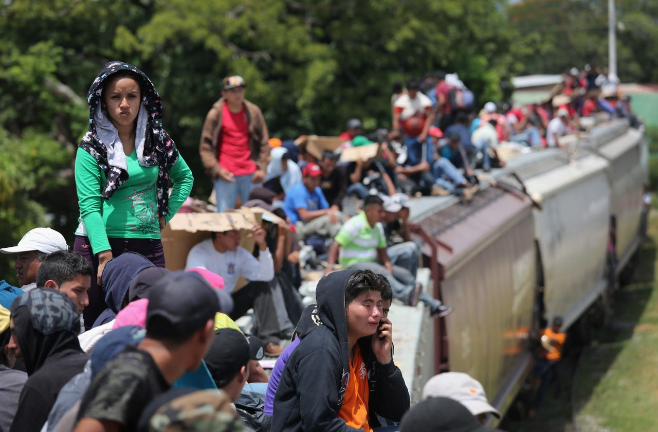 Thousands of Central Americans ride atop trains, known as La Bestia, or the Beast, through Mexico to reach the U.S. Aug. 6, 2013, near Juchitan, Mexico.