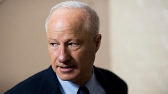UNITED STATES - NOVEMBER 30: Rep. Mike Coffman, R-Colo., leaves the House Republican Conference meeting in the Capitol on Wednesday, Nov. 30, 2016. (Photo By Bill Clark/CQ Roll Call)