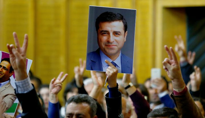 A supporter holds a portrait of Selahattin Demirtas.