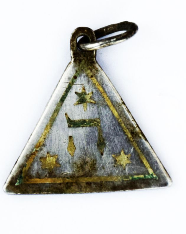 One side of the pendant discovered in the Sobibór Nazi death camp along the route that once led...