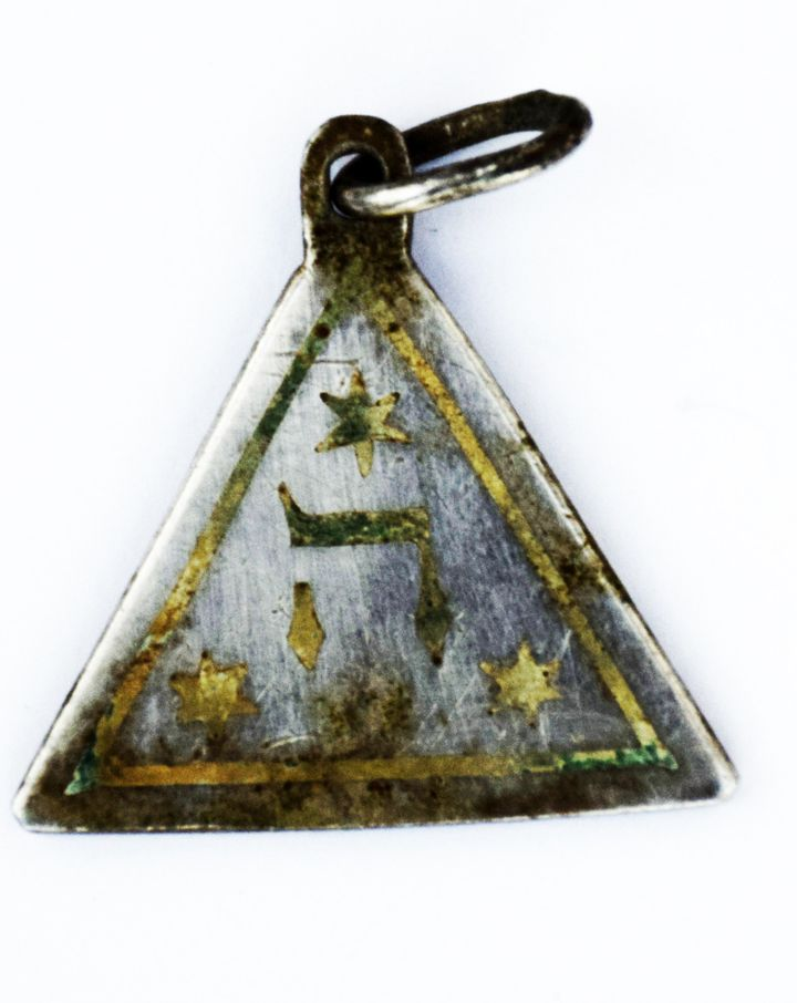 One side of the pendant discovered in the Sobibór Nazi death camp along the route that once led to the gas chambers.