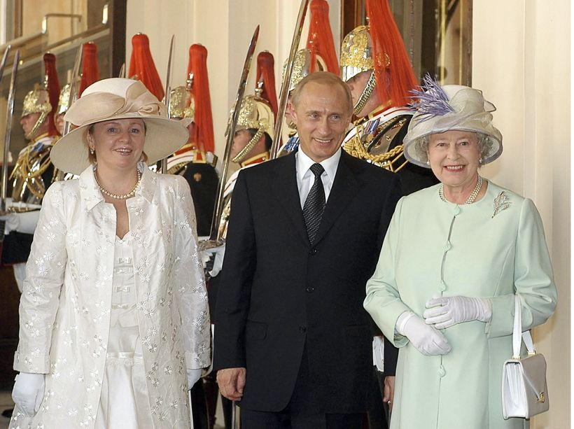 Putin and his wife Lyudmila meet with Queen Elizabeth II during their 2003 state visit to Great Britain.