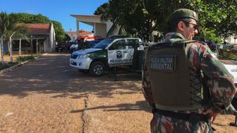 An agent of the Military Police stands guard at the Alcacuz Penitentiary Center near Natal, Rio Grande do Norte state, northeastern Brazil where a riot is thought to have killed more than 30 people, some of them beheaded on January 14, 2017.  Officials said Sunday members of two separate drug gangs had come out of different parts of the prison and clashed violently.    / AFP / Johannes MYBURGH        (Photo credit should read JOHANNES MYBURGH/AFP/Getty Images)