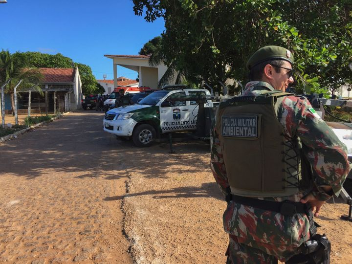 An agent of the Military Police stands guard at the Alcacuz Penitentiary Center near Natal, Rio Grande do Norte state, northeastern Brazil.
