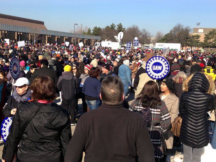 People wait for the start of a health care rally in Warren, Michigan, north of Detroit, on Sunday.