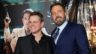"""Director and cast member Ben Affleck (R) poses with actor Matt Damon at the premiere of """"Live by Night"""" in Hollywood, California U.S., January 9, 2017.   REUTERS/Mario Anzuoni"""