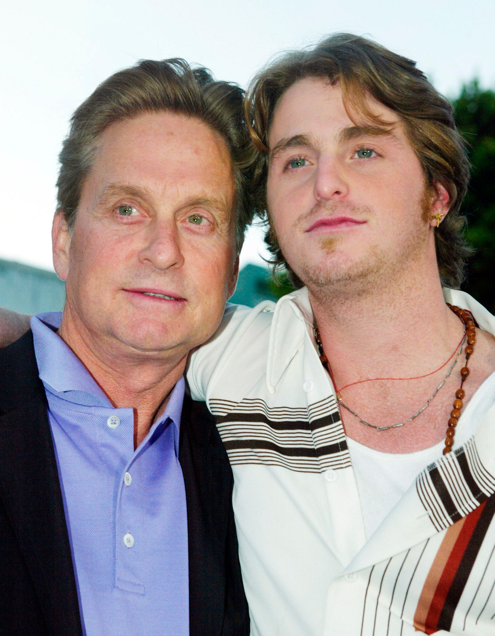 """Actor Michael Douglas (L) and his son Cameron pose as they arrive for the premiere of their new film """"It Runs In The Family"""" in this file photo taken in Los Angeles, California, April 7, 2003. Cameron Douglas, the son of Oscar-winning actor Michael Douglas, has been arrested on drug charges, media reports and authorities said on Monday.       REUTERS/Fred Prouser/Files   (UNITED STATES ENTERTAINMENT CRIME LAW SOCIETY)"""