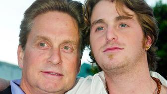 "Actor Michael Douglas (L) and his son Cameron pose as they arrive for the premiere of their new film ""It Runs In The Family"" in this file photo taken in Los Angeles, California, April 7, 2003. Cameron Douglas, the son of Oscar-winning actor Michael Douglas, has been arrested on drug charges, media reports and authorities said on Monday.       REUTERS/Fred Prouser/Files   (UNITED STATES ENTERTAINMENT CRIME LAW SOCIETY)"