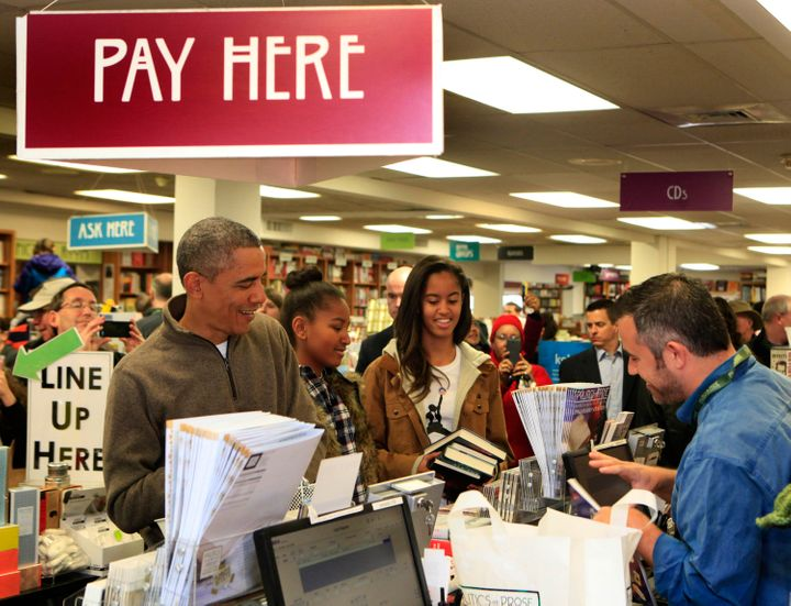 President Barack Obama and his daughters shopping at Politics and Prose, a bookstore in Washington, D.C., in 2014.