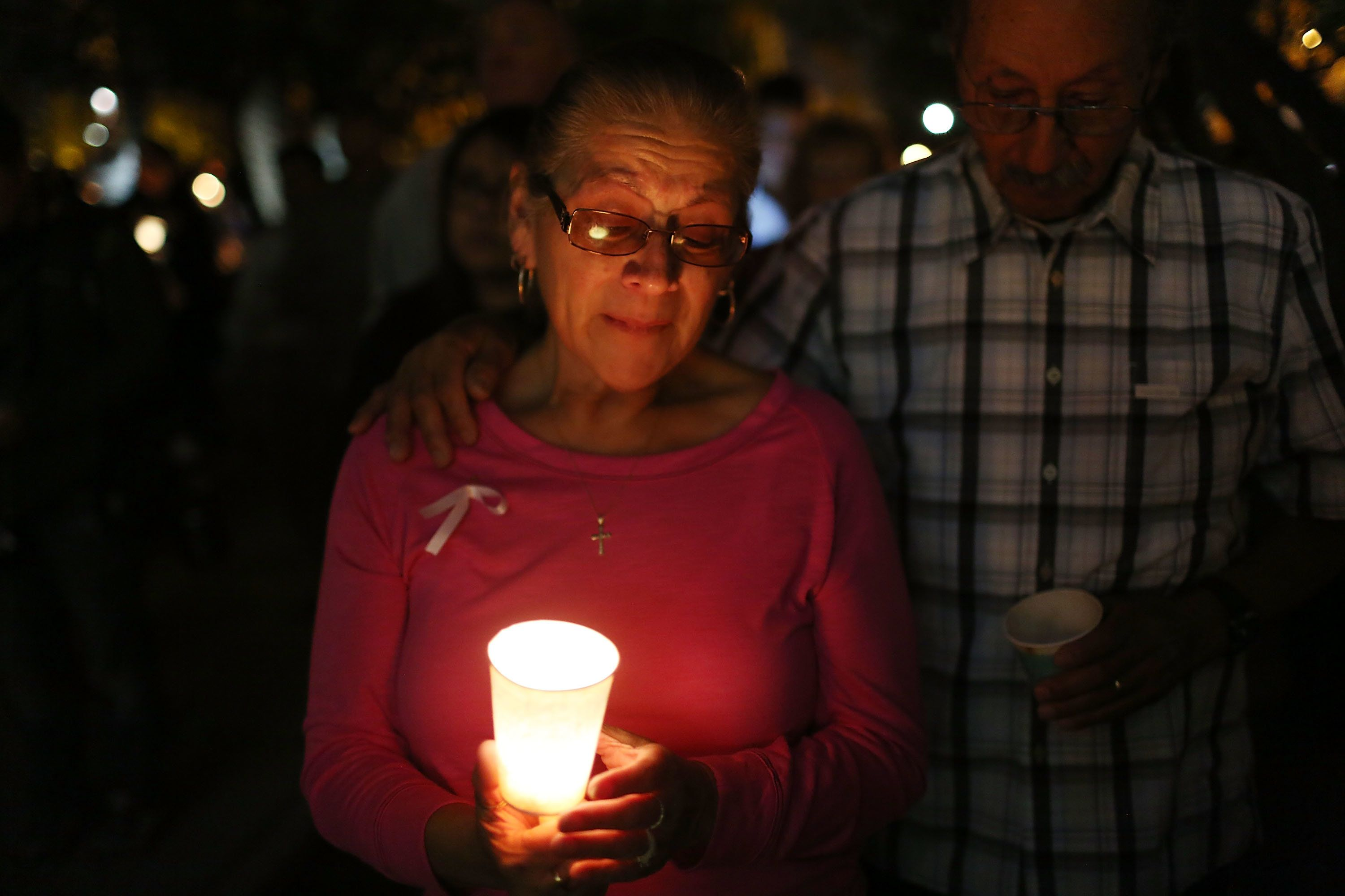 SAN BERNARDINO, CA - DECEMBER 07:  Arlene Payan and Ralph Payan (R)  attend a vigil held at the San Bernardino County Board of Supervisors headquarters to remember those injured and killed during the shooting at the Inland Regional Center on December 7, 2015 in San Bernardino, California. FBI and other law enforcement officials continue to investigate the mass shooting that left 14 people dead and another 21 injured on December 2.  (Photo by Joe Raedle/Getty Images)