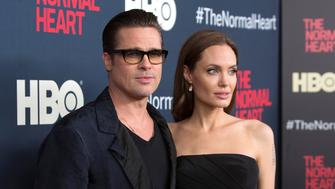"Actors Brad Pitt and Angelina Jolie attend the premiere of ""The Normal Heart"" in New York May 12, 2014. REUTERS/Andrew Kelly/File Photo"