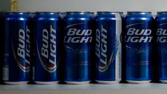 Cans of Anheuser-Busch InBev NV Bud Light brand beer sit on a shelf in a liquor store in Chillicothe, Illinois, U.S., on Thursday, Sept. 17, 2015. Anheuser-Busch InBev NV unveiled plans to acquire SABMiller Plc yesterday, a deal that may cost the Budweiser brewer more than $100 billion as it seeks to unite the world's two biggest beermakers. Photographer: Daniel Acker/Bloomberg via Getty Images
