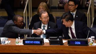 China's President Xi Jinping (R) shakes hands with the President of Kenya Uhuru Kenyatta (C) as UN Secretary-General Ban Ki-moon watches before the start of the Global Leaders Meeting on Gender Equality and Womens Empowerment: A Commitment to Action on September 27, 2015 at the United Nations in New York. AFP PHOTO/DON EMMERT        (Photo credit should read DON EMMERT/AFP/Getty Images)