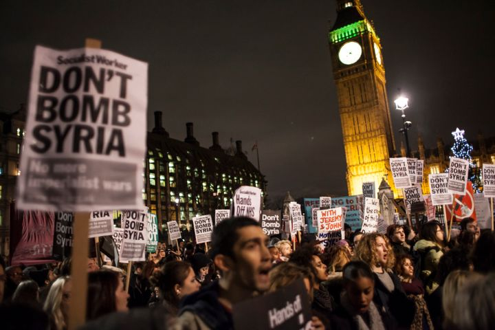 Dozens of anti-war protesters demonstrated against the vote outside Parliament in London.