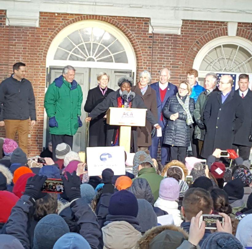 Members of the Massachusetts delegation stand behind SEIU organizer Julie Gonzalez. Boston Mayor Martin J. Walsh is on right.