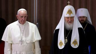 Pope Francis (L) and Russian Orthodox Patriarch Kirill stand together after a meeting in Havana, February 12, 2016. REUTERS/Alejandro Ernesto/Pool