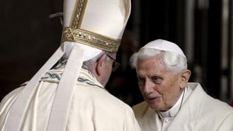 Pope Francis (L) meets Emeritus Pope Benedict XVI before open the Holy Door to mark opening of the Catholic Holy Year, or Jubilee, in St. Peter's Basilica, at the Vatican, December 8, 2015.  REUTERS/Max Rossi