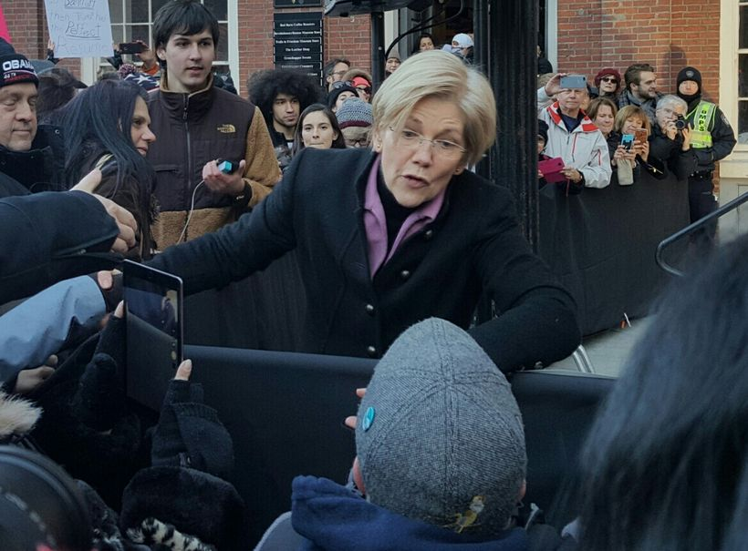 Sen. Elizabeth Warren greets audience members at Jan. 15 Boston rally for the ACA.