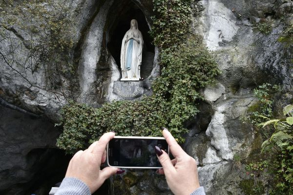 Pope Benedict XVI blesses worshippers as he arrives at the Massabielle cave of the Lourdes shrine, in Lourdes, France, in 200