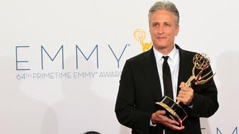"Jon Stewart hold the Emmy award for outstanding variety series for ""The Daily Show With Jon Stewart"" at the 64th Primetime Emmy Awards in Los Angeles September 23, 2012.  REUTERS/Mario Anzuoni (UNITED STATES  Tags: ENTERTAINMENT) (EMMYS-BACKSTAGE)"