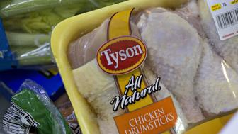 A package of Tyson Foods Inc. chicken is arranged for a photograph in Tiskilwa, Illinois, U.S., on Thursday, May 5, 2016. Tyson is scheduled to release earnings figured on May 9. Photographer: Daniel Acker/Bloomberg via Getty Images