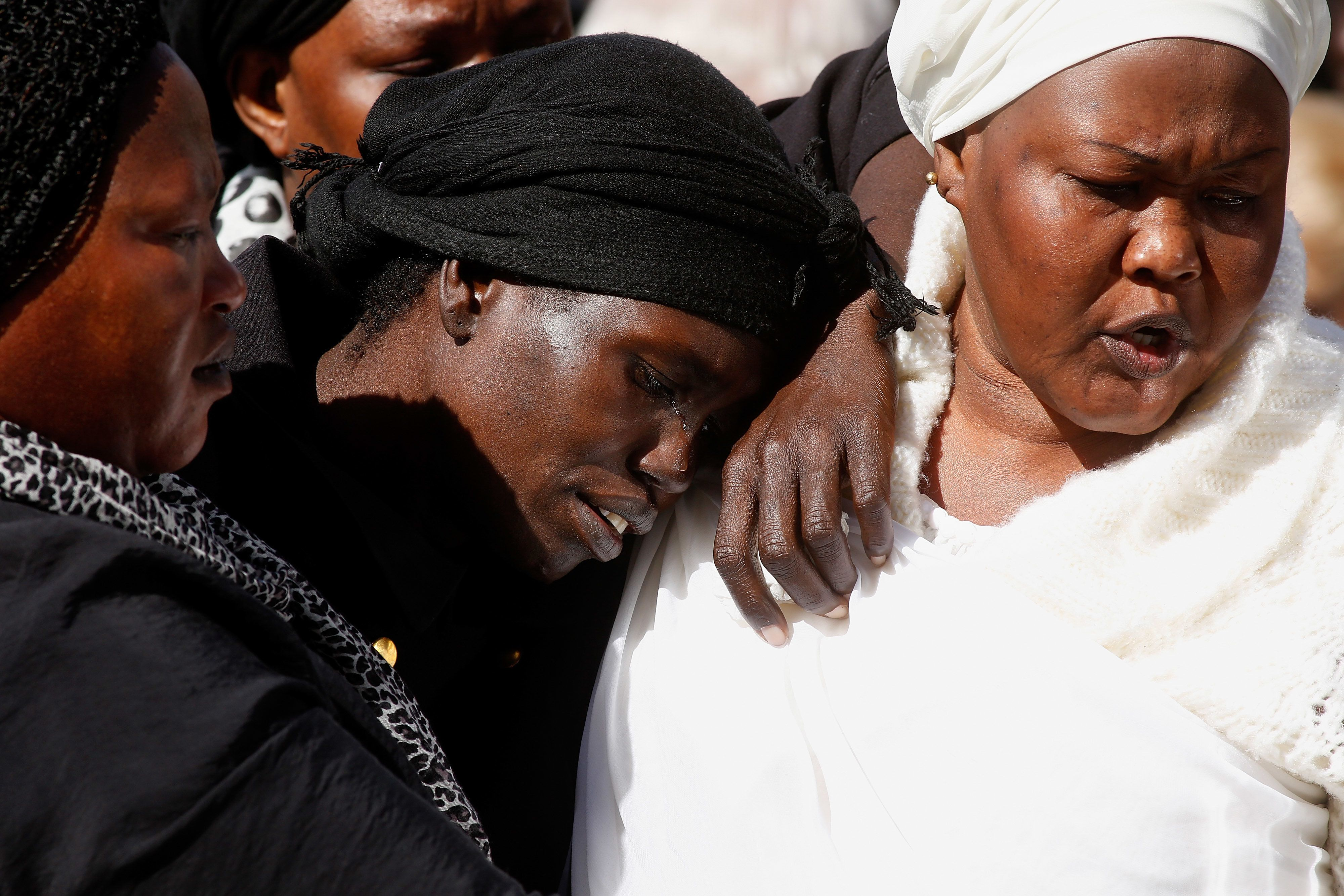 MELBOURNE, AUSTRALIA - APRIL 18:  Akon Guode, 35, at the funeral of her 3 children Bol, Anger and Madit who were tragically killed when she veered off the road at Wyndham Lakes on April 8, 2015, at St Andrews Catholic Church on April 18, 2015 in Melbourne, Australia.  (Photo by Paul Jeffers/Getty Images)