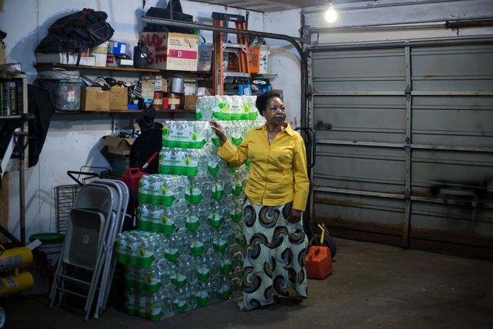 Darlene McClendon, 62, with a stockpile of bottled water at her home in Flint, Michigan, on October 11, 2016. McClendon, a 6t
