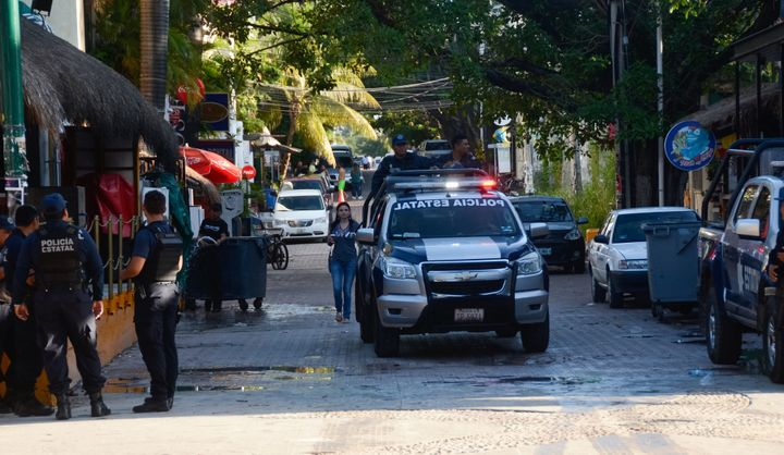 Mexican police agents patrol near a nightclub in Playa del Carmen, Quintana Roo state, Mexico where 5 people were killed, thr