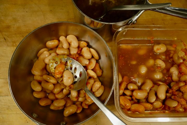 <p>Lifting the beans out of their broth leaves behind the hottest part</p>