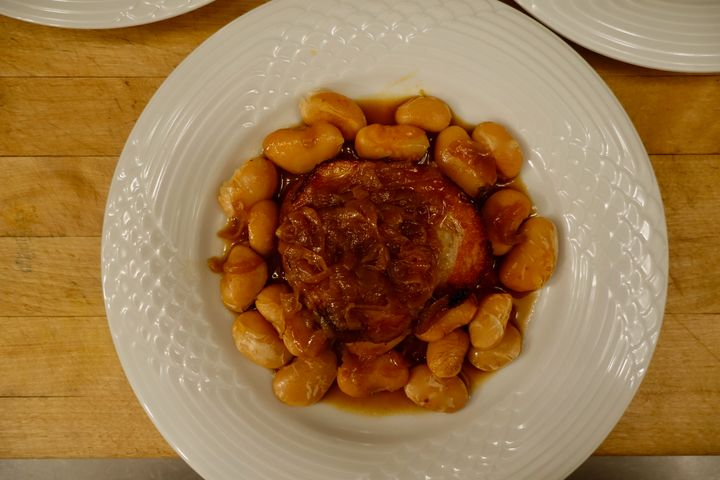 <p>Braised pork belly with onions and 'nduja beans</p>