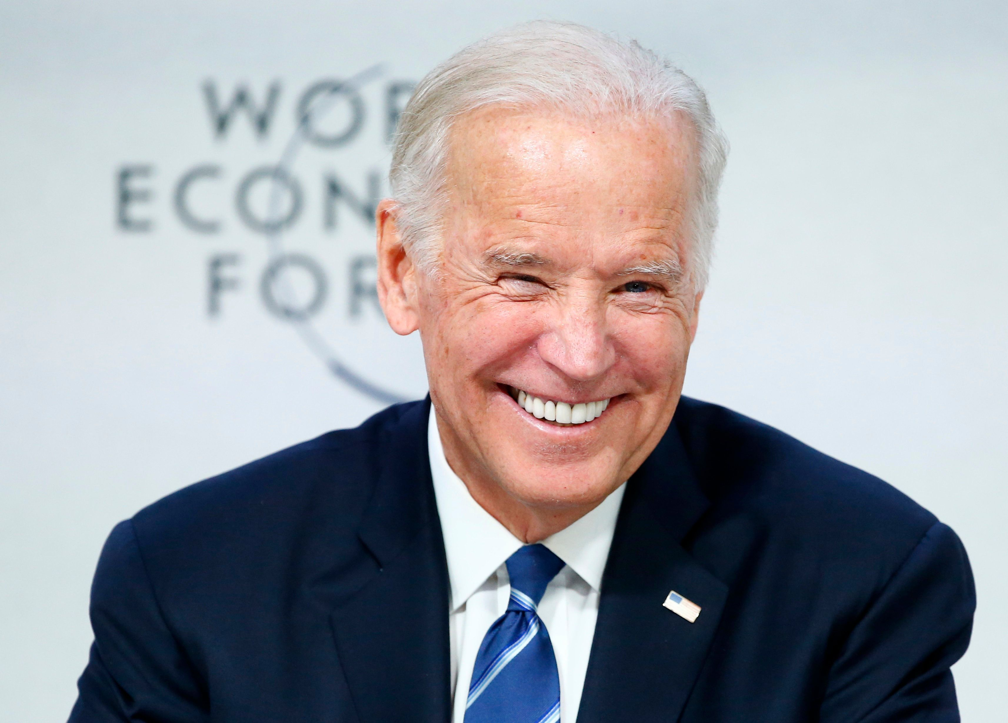 """U.S. Vice President Joe Biden smiles during the session """"Cancer Moonshot: A Call to Action"""" during the annual meeting of the World Economic Forum (WEF) in Davos, Switzerland January 19, 2016. REUTERS/Ruben Sprich"""