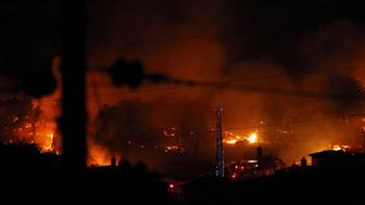 SAN BRUNO, CA - SEPTEMBER 09:  Flames consume homes during a massive fire in a residential neighborhood September 9, 2010 in San Bruno, California. A massive gas line explosion likely rocked a neighborhood near San Francisco International Airport.  (Photo by Ezra Shaw/Getty Images)