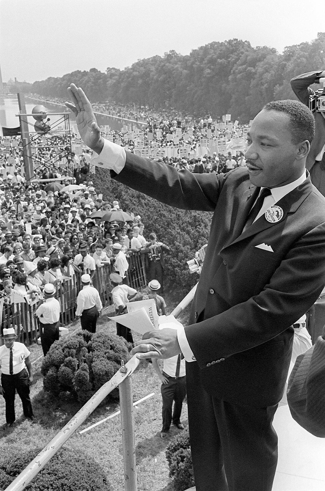 (FILES) US civil rights leader Martin Luther KIng waves to supporters 28 August 1963 from the Lincoln Memorial on the Mall in Washington DC during the 'March on Washington'. On the steps of the Lincoln Memorial, King delivered his 'I Have a Dream' speech, which is credited with mobilizing supporters of desegregation and prompted the 1964 Civil Rights Act. 28 August, 2003 marks the 40th anniversay of the speech. King was assassinated on 04 April 1968 in Memphis, Tennessee by James Earl Ray, who confessed to the shooting and was sentenced to 99 years in prison. AFP PHOTO/FILES  (Photo credit should read -/AFP/Getty Images)