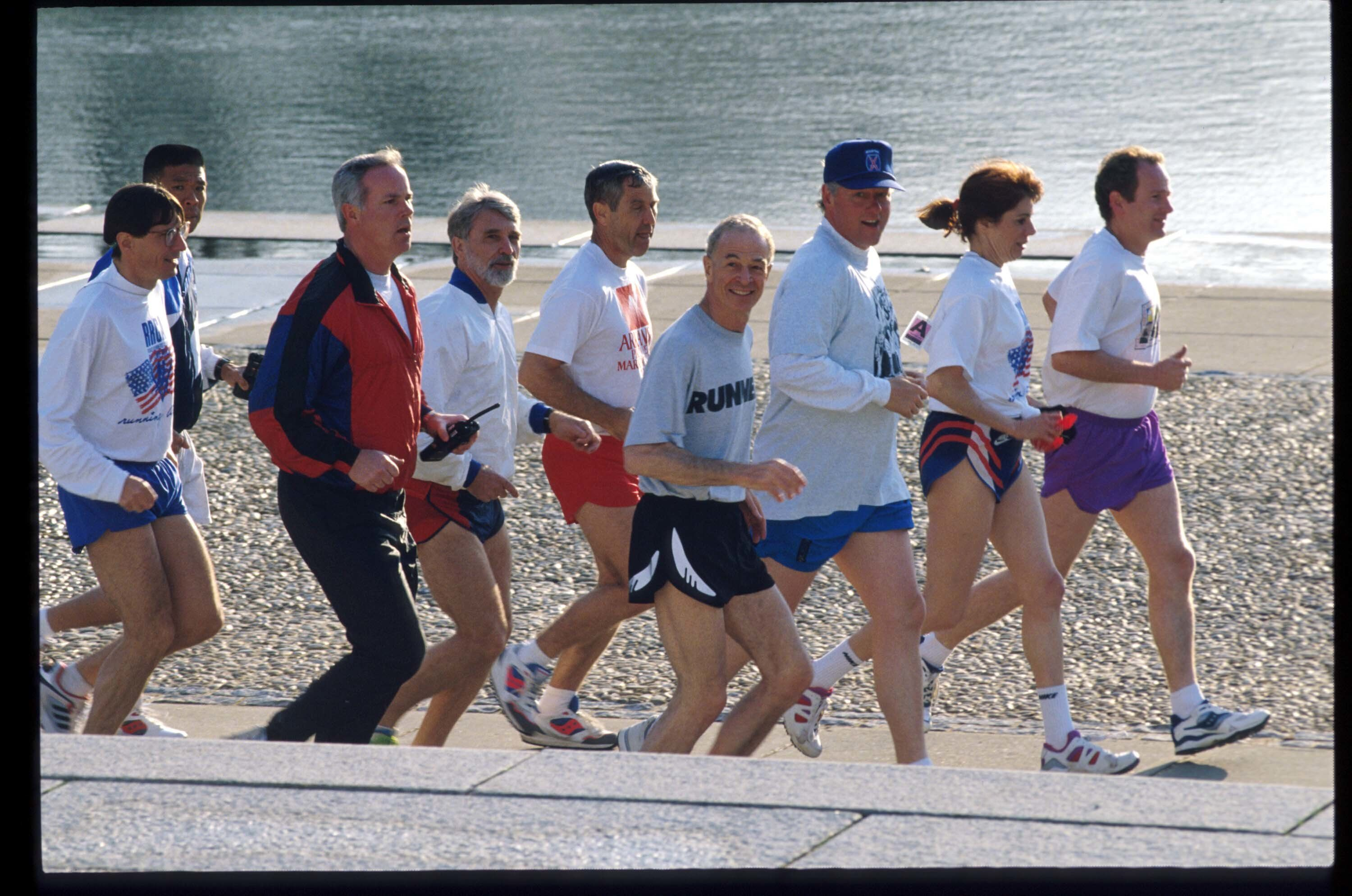 206540 01: (NO NEWSWEEK - NO USNEWS) President Bill Clinton jogs with an entourage April 7, 1994 in Washington, DC. President Clinton stays fit with a daily regimen of walking and jogging. (Photo by Diana Walker/Liaison)