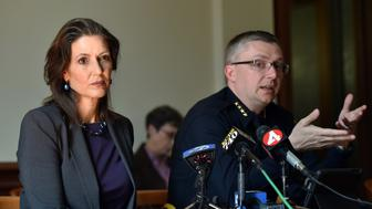 Oakland Mayor Libby Schaaf (L) and Oakland Police Chief Sean Whent (R) speak to members of the media about vandalism and property damage that ensued during yesterday's May Day protest in Oakland, California on May 2, 2015. Hundreds marched throughout the city on May 1 to mark International Workers' Day vandalizing store fronts, smashing windows and lighting a car on fire before eventually dispersing.    AFP PHOTO/JOSH EDELSON        (Photo credit should read Josh Edelson/AFP/Getty Images)