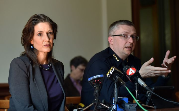 Oakland Mayor Libby Schaaf (L) and Oakland Police Chief Sean Whent (R) speak to members of the media about vandalism and prop