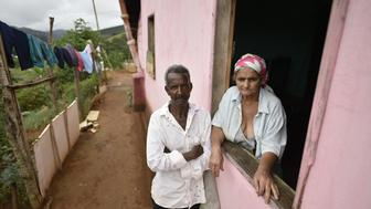 Pedro Joel de Oliveira (L) and Teresinha Gomes de Oliveira, the parents of Wellington Santos Cardoso, a victim of suspected yellow fever, stand at their home in Piedade de Caratinga in the southeastern Brazilian state of Minas Gerais, on January 13, 2017. Health authorities of Minas Gerais decreed a health emergency in 152 cities and towns due to a likely outbreak of yellow fever. There have been 110 suspected cases of yellow fever in the state, with 30 probable deaths, so far this year.  / AFP / DOUGLAS MAGNO        (Photo credit should read DOUGLAS MAGNO/AFP/Getty Images)