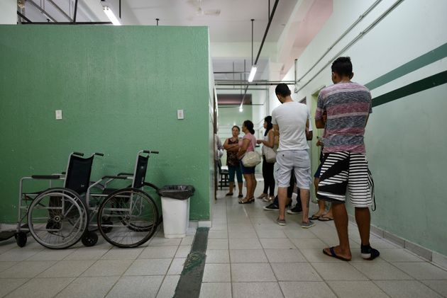 People line up to receive the yellow fever vaccine at a public health post in Caratinga, in the southeastern...