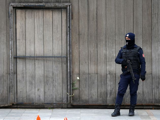 A Turkish policeman stands guard in front of the Reina nightclub which was attacked by a gunman, in Istanbul,...