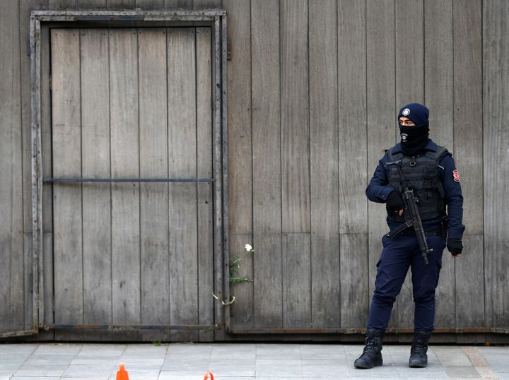 A Turkish policeman stands guard in front of the Reina nightclub which was attacked by a gunman, in Istanbul, Turkey, January