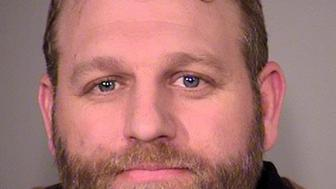 Ammon Bundy is seen in a police jail booking photo released by the Multnomah County Sheriff's Office in Portland, Oregon January 27, 2016. One protester was shot dead and eight others were arrested on Tuesday after authorities confronted members of an armed group that has staged a month-long occupation of a federal wildlife reserve in Oregon, activists and officials said.  REUTERS/MCSO/Handout via Reuters FOR EDITORIAL USE ONLY. NOT FOR SALE FOR MARKETING OR ADVERTISING CAMPAIGNS. THIS IMAGE HAS BEEN SUPPLIED BY A THIRD PARTY. THIS PICTURE WAS PROCESSED BY REUTERS TO ENHANCE QUALITY. AN UNPROCESSED VERSION HAS BEEN PROVIDED SEPARATELY