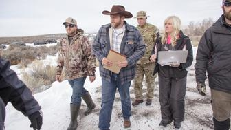 Ammon Bundy(C), leader of a group of armed anti-government protesters, arrives to speak to the media at the Malheur National Wildlife Refuge near Burns, Oregon January 4, 2016. The FBI on January 4 sought a peaceful end to the occupation by armed anti-government militia members at a US federal wildlife reserve in rural Oregon, as the standoff entered its third day. The loose-knit band of farmers, ranchers and survivalists -- whose action was sparked by the jailing of two ranchers for arson -- said they would not rule out violence if authorities stormed the site, although federal officials said they hope to avoid bloodshed. AFP PHOTO / ROB KERR / AFP / ROB KERR        (Photo credit should read ROB KERR/AFP/Getty Images)