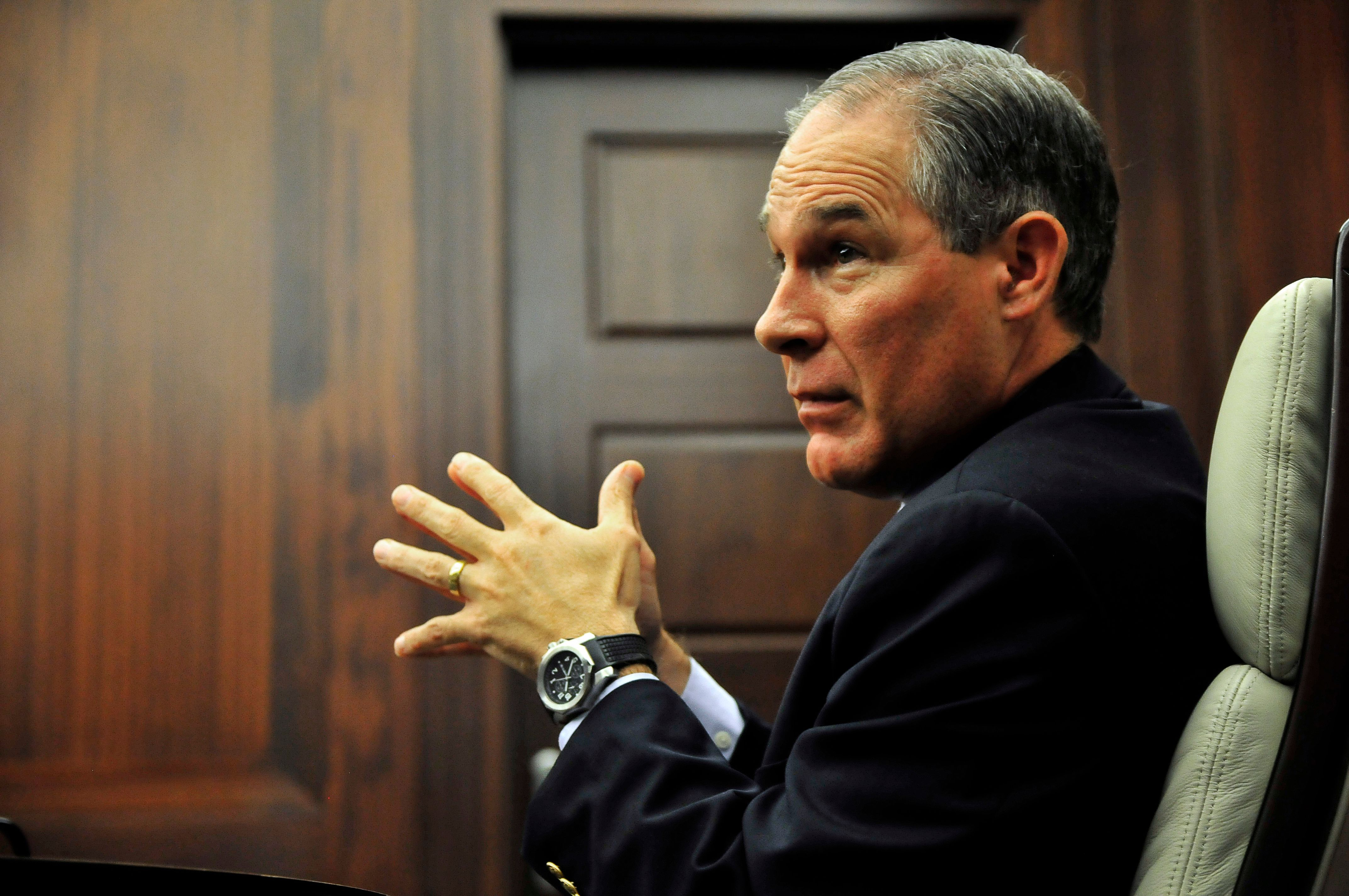Oklahoma Attorney General Scott Pruitt in a meeting at his office in Oklahoma City, July 29, 2014. Picture taken July 29, 2014.   REUTERS/Nick Oxford