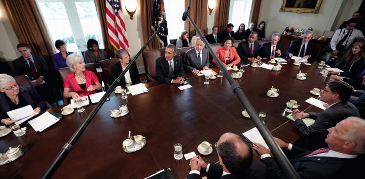 U.S. President Barack Obama (C) makes briefs remarks to the news media at the beginning of a cabinet meeting. White House Chi