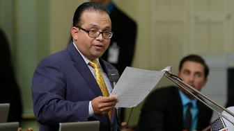 Assemblyman Luis Alejo, D-Watsonville, urges passage of his measure that makes it illegal to buy a gun control measure at the Capitol in Sacramento, Calif., Thursday, Aug. 28, 2014. By a 48-24 vote the Assembly approved Alejo's bill, AB1609 that will make it illegal to buy a gun from out-of-state without going through a licensed dealer in California and sent it to the governor. (AP Photo/Rich Pedroncelli)