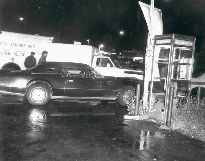 """Revere, Massachusetts bar owner, Eddie Connors' body is shown lying dead in a phone booth in this handout photo provided by the U.S. Attorney's Office in Massachusetts June 19, 2013. The photo was used as evidence during the trial of accused mob boss James """"Whitey"""" Bulger, who is on trial for racketeering and 19 murders that occurred in the 1970s and 80s."""