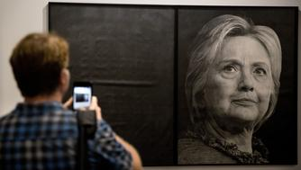 A visitor uses a smartphone to photograph a graphite portrait of Hillary Clinton, former 2016 Democratic presidential nominee, by Karl Haendel on display during Art Basel Miami Beach in Miami, Florida, U.S., on Friday, Dec. 2, 2016. Politics is prevalent at Art Basel this week, where artists and galleries are using the biggest contemporary art fair in the U.S. to express frustration and other feelings in the wake of the presidential election. Photographer: Scott McIntyre/Bloomberg via Getty Images