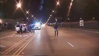 Laquan McDonald (R) walks on a road before he was shot 16 times by police officer Jason Van Dyke in Chicago, in this still image taken from a police vehicle dash camera video shot on October 20, 2014, and released by Chicago Police on November 24, 2015. Van Dyke, a white Chicago policeman was charged on Tuesday with murdering black teenager McDonald, a prosecution that was speeded up in hopes of staving off a fresh burst of the turmoil over race and police use of deadly force that has shaken the U.S. for more than a year. REUTERS/Chicago Police Department/Handout via Reuters ATTENTION EDITORS - THIS IMAGE HAS BEEN SUPPLIED BY A THIRD PARTY. FOR EDITORIAL USE ONLY. NOT FOR SALE FOR MARKETING OR ADVERTISING CAMPAIGNS. IT IS DISTRIBUTED, EXACTLY AS RECEIVED BY REUTERS, AS A SERVICE TO CLIENTS
