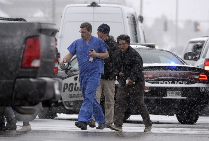 People are rescued near the scene of a shooting at the Planned Parenthood clinic in Colorado Springs, Colorado, on Nov. 27, 2