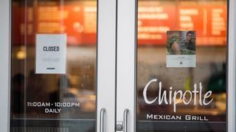 BOSTON, MA - DECEMBER 08:  A sign showing that the Chipotle Mexican Grill seen at 1924 Beacon St. is closed on December 8, 2015 in Boston, Massachusetts. According to Boston College spokesman, 80 students have gotten sick after eating at the fast food chain.  (Photo by Scott Eisen/Getty Images)